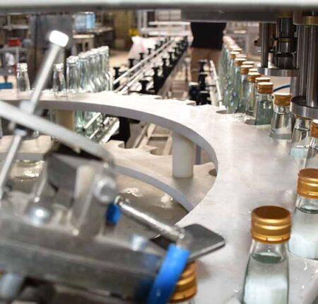 دستگاه پرکن شیشه عرقیات